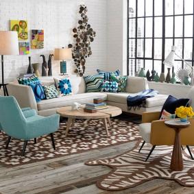 Зонирование гостиной в квартире красивыми ковриками