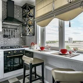 Стол-подоконник в интерьере кухни