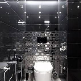 Интерьер туалета с темной плиткой