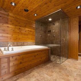 Каменная плитка на полу в ванной