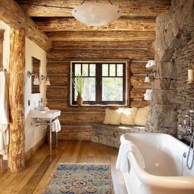 Акриловая ванна возле каменной стены