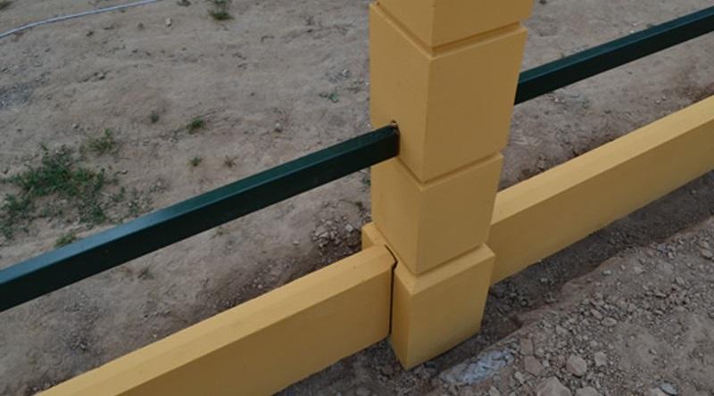 Окраска в желтый цвет бетонных деталей садового забора