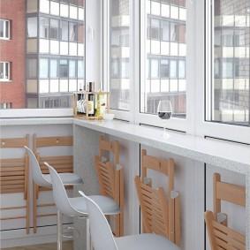 Интерьер небольшого балкона с барной стойкой