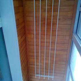Фото сушилки для белья на потолке балкона