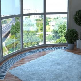 Встроенная система отопления под панорамным окном лоджии