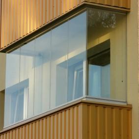 Обшивка профлистом нижней части балкона