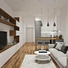Белая мебель в длинной комнате