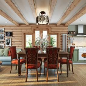Столовая зона в кухне-гостиной частного дома