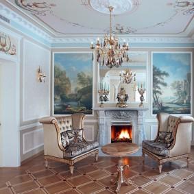 Интерьер небольшой комнаты с камином и картинами