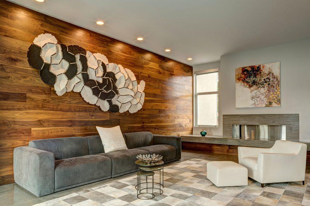 Оформление стен в гостиной картинками
