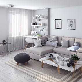 Угловой диван в комнате с рабочей зоной