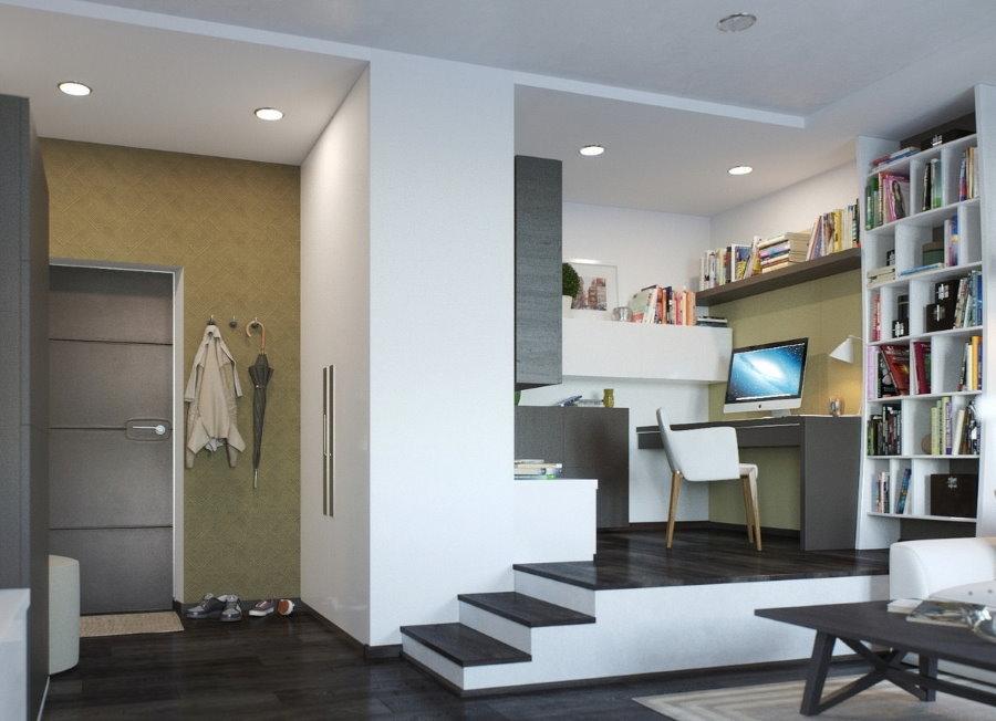 Рабочее место на подиуме в квартире студийной планировки
