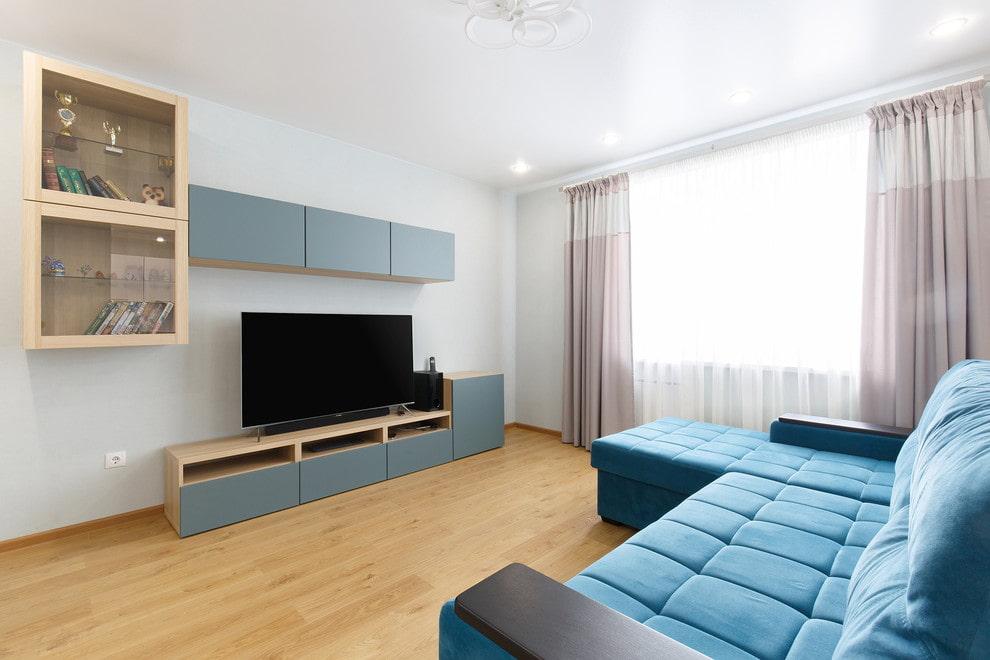 Модульная стенка в гостиной современного стиля