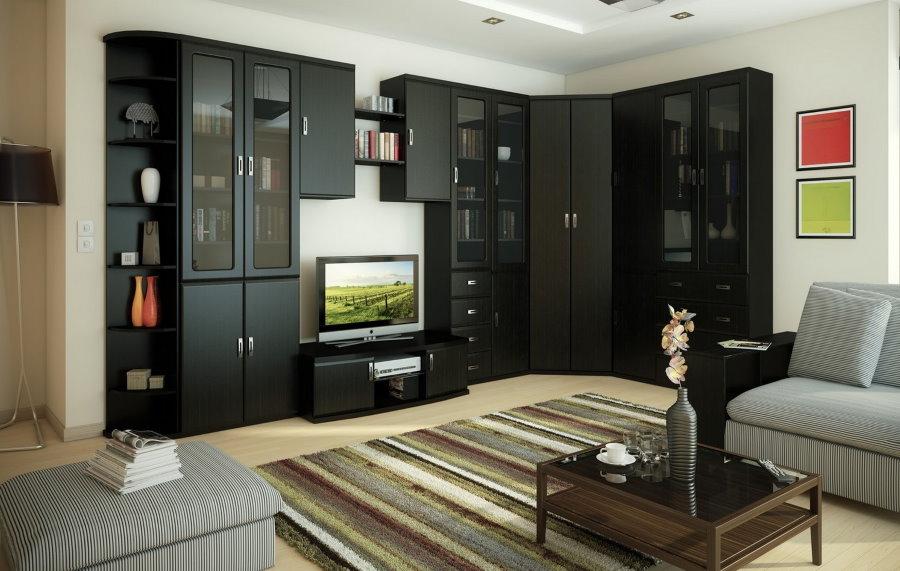 Черная угловая стенка в гостиной с белыми обоями