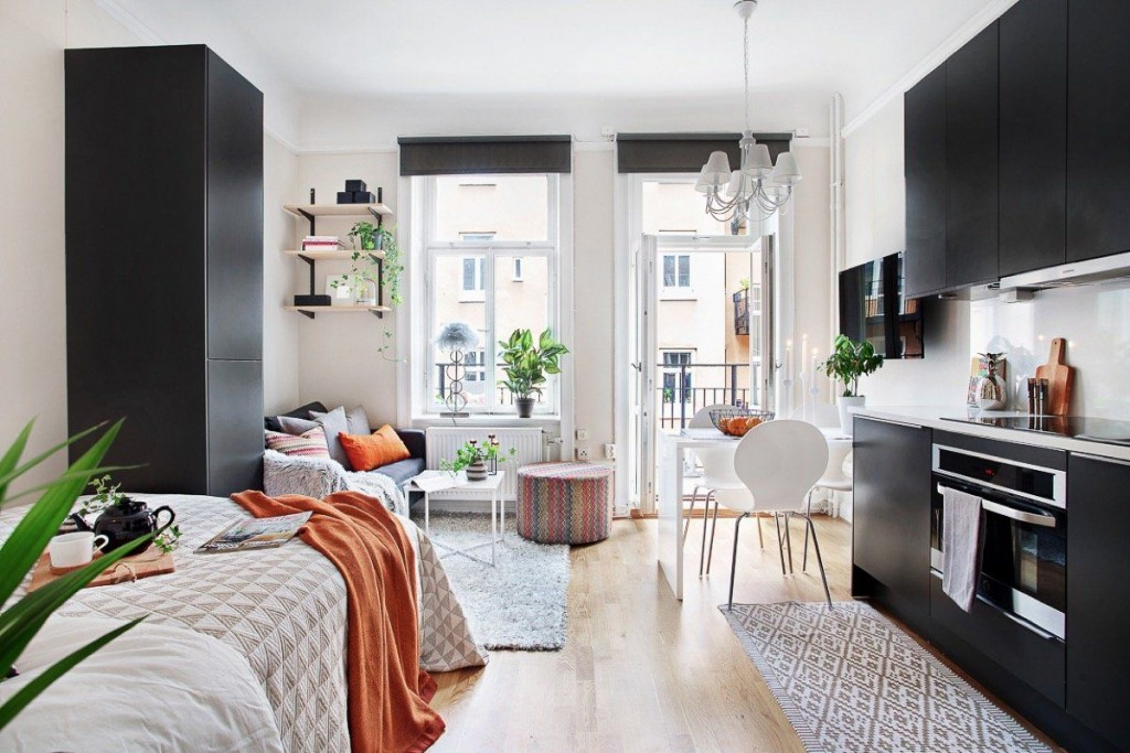 Черная мебель в квартире-студии площадью 25 кв м