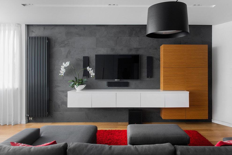 Белая подвесная тумба под телевизором в гостиной