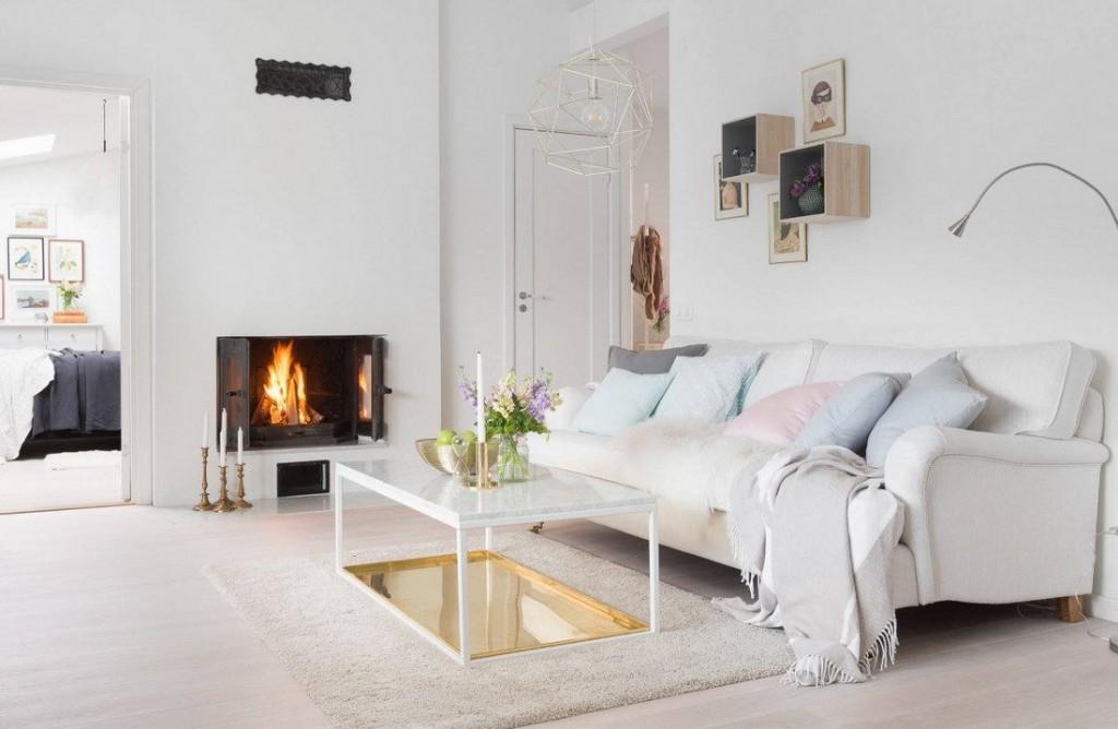 Интерьер белой гостиной с электрическим камином