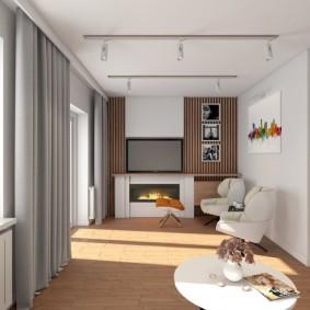 Дизайн гостиной комнаты с электрокамином под телевизором