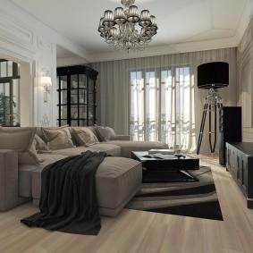 Черная мебель напротив углового дивана