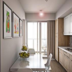 Белый стол вдоль стены в узкой кухне