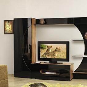 Черная стенка с тумбочкой под небольшой телевизор