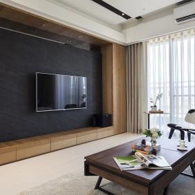 Плазменная панель на черной стене гостиной