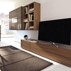 Телевизионная панель на тумбе коричневого цвета
