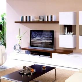 ТВ-тумба в интерьере гостиной комнаты