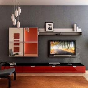 Красная тумба в гостиной с серыми стенами