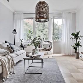 Интерьер гостиной комнаты в скандинавском стиле