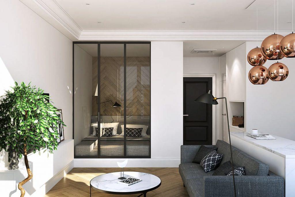 Серый диван в мягкой зоне квартиры студийного типа