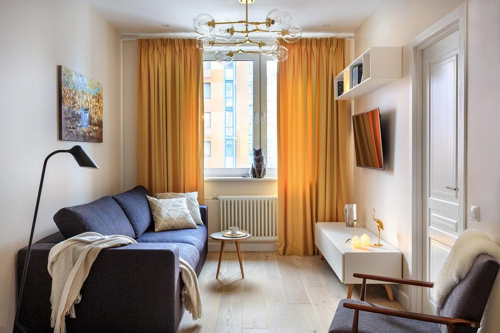 Желтые шторы в гостиной комнате площадью 12 кв м