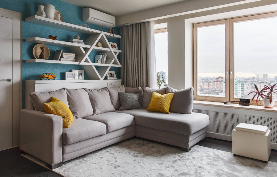 Угловой диван со спальным местом в гостиной