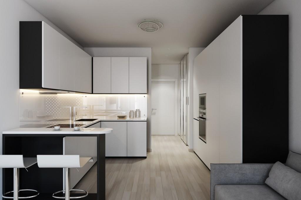 Черно-белая мебель в кухонной зоне студии