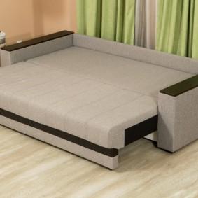 Разложенный прямой диван со спальным местом