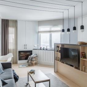 Телевизионная зона в квартире студии площадью 25 кв м