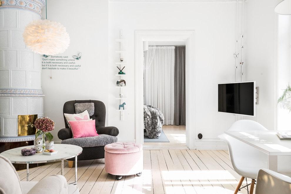 Телевизор в интерьере гостиной скандинавского стиля