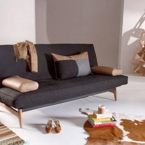 Узкий диван-книжка с темной обивкой