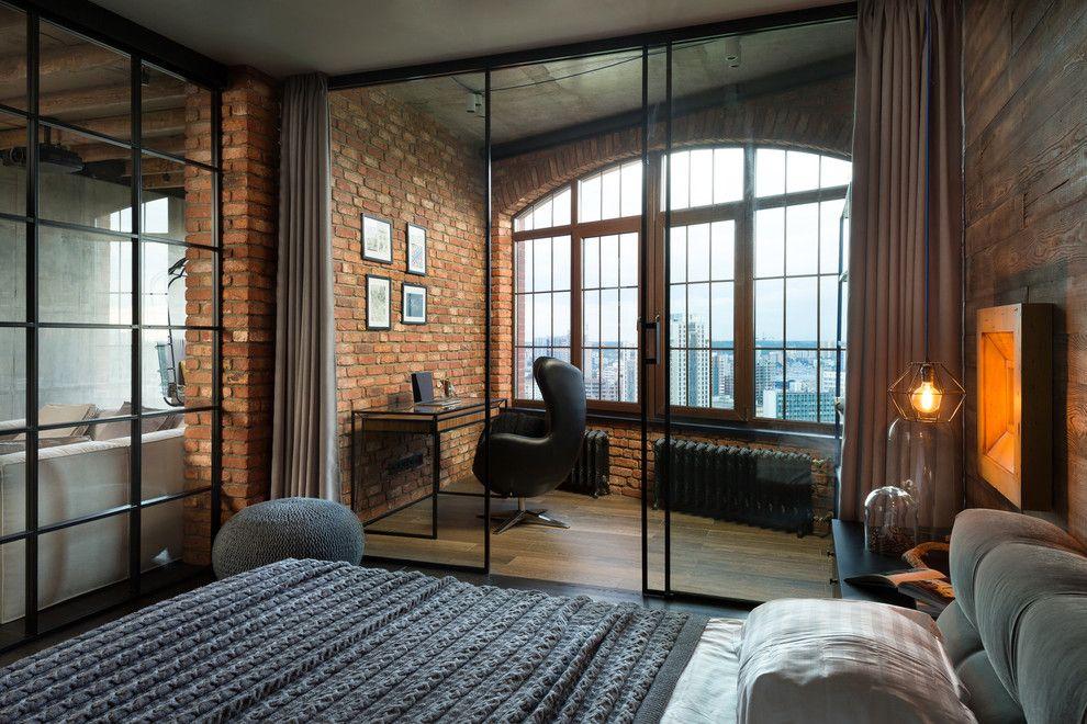 Стеклянная перегородка в квартире-студии стиля лофт