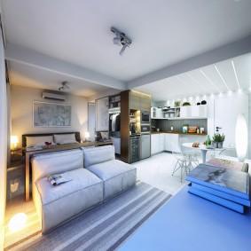 Круглый светильник на полу возле кровати
