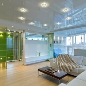 Освещение большой гостиной с натяжным потолком