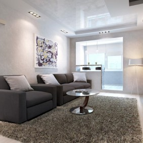 Мягкая мебель в зале стиля минимализма