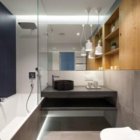 Комфортное освещение ванной комнаты в современном стиле