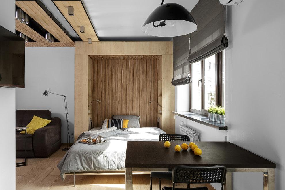 Зонирование отделкой спальни-гостиной