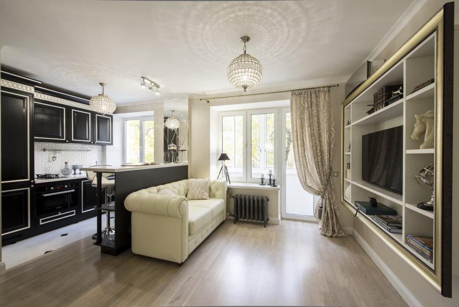 Черный гарнитур в квартире-студии классического стиля
