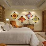 Оформление акцентной стены в спальне в стиле капитоне