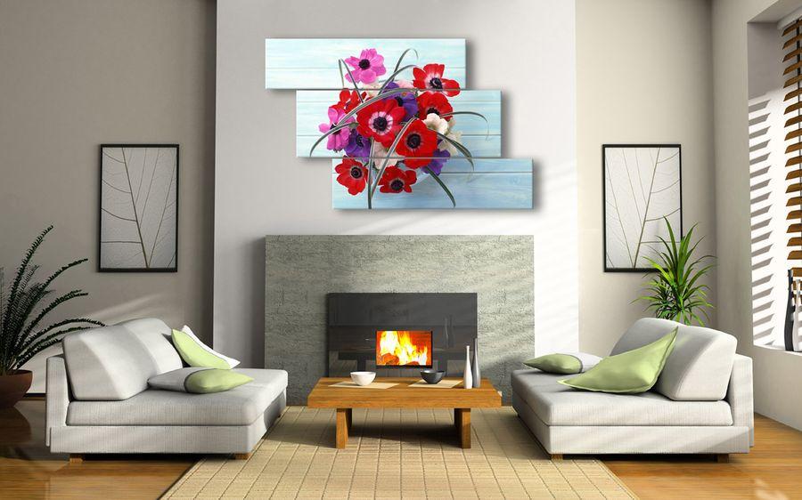 Картины в интерьере гостиной над камином
