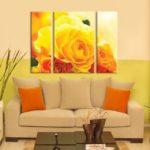 Картины в интерьере гостиной триптих в желто-оранжевом колорите