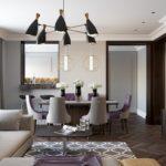 Оформление гостиной с корпусной стенкой и столовой зоной
