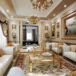 Оформление классической гостиной с картинами в багетах и стеклянным столиком
